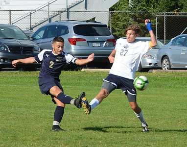 South's Nick Santos (2) and Sean Finneyfrock (27) go all out for possession.