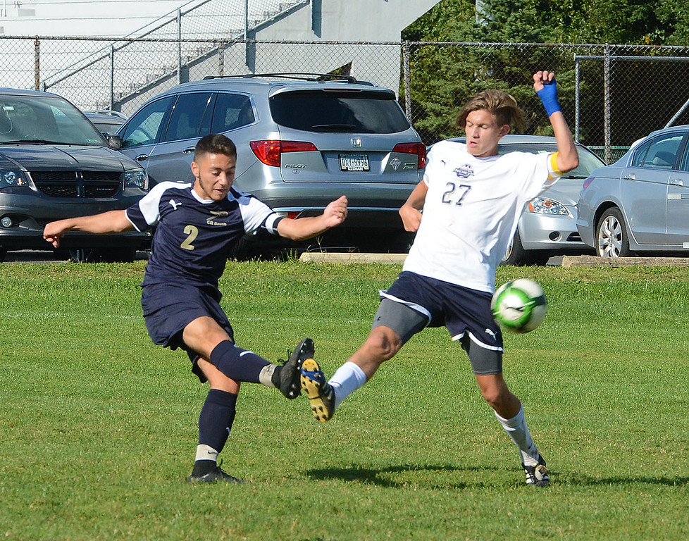 . South\'s Nick Santos (2) and Sean Finneyfrock (27) go all out for possession.