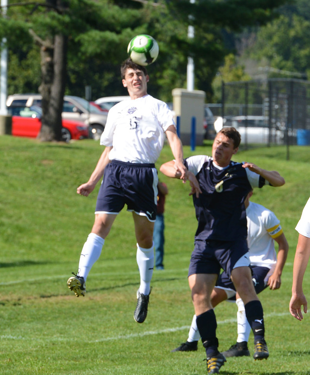 . Jeremy Smithline (16) wins header over Conor Nelms (8).