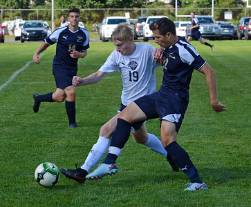 North's T.J. Grube (19)  and Dan Maggio (22) battle for possession.