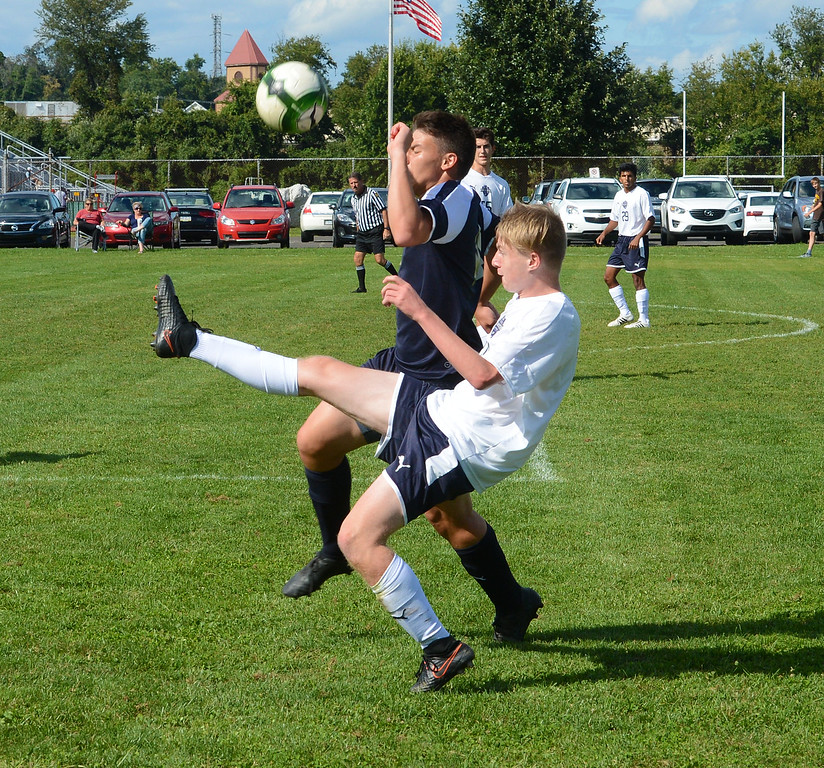 . T.J. Grube (19) reverses field with overhead kick.