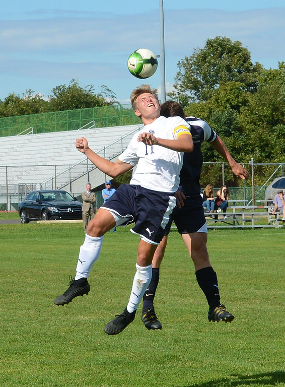 . CR North\'s Connor O\'Donnell (11) battles for header with Conor Nelms (8).