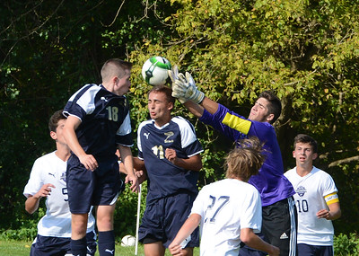 CR South's T.J. Rodman (18), Anthony Ritts (11) and Drew Bresnan (00) combine on Golden Hawks' save.