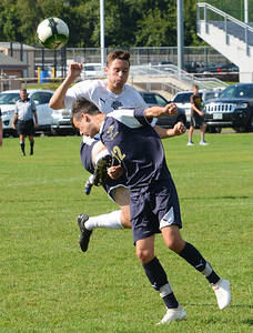 North's Ryan Pave (17) and Oscar Buynevich (12) collide going for the ball.