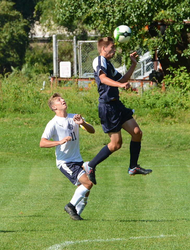 CR South's Anthony Ritts (11) goes high for header.