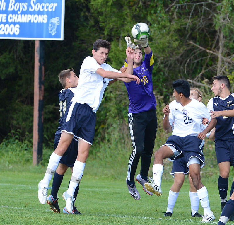 . CR South GK Drew Bresnan (00) makes save between Zach Saifer (55) and Akash Shah (29).