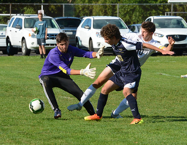 North's Justin Scharf (10) tries to get ball by South GK Drew Bresnan (00) and Hawks defender Paul Chorobski (13).