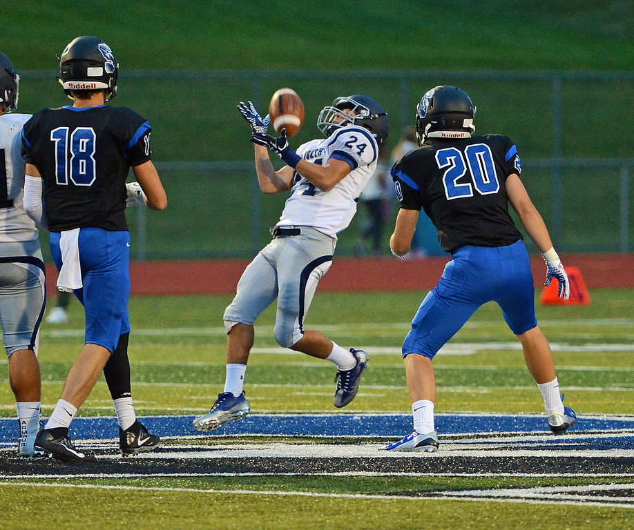 . Nick Muro (24) gets set to return punt.