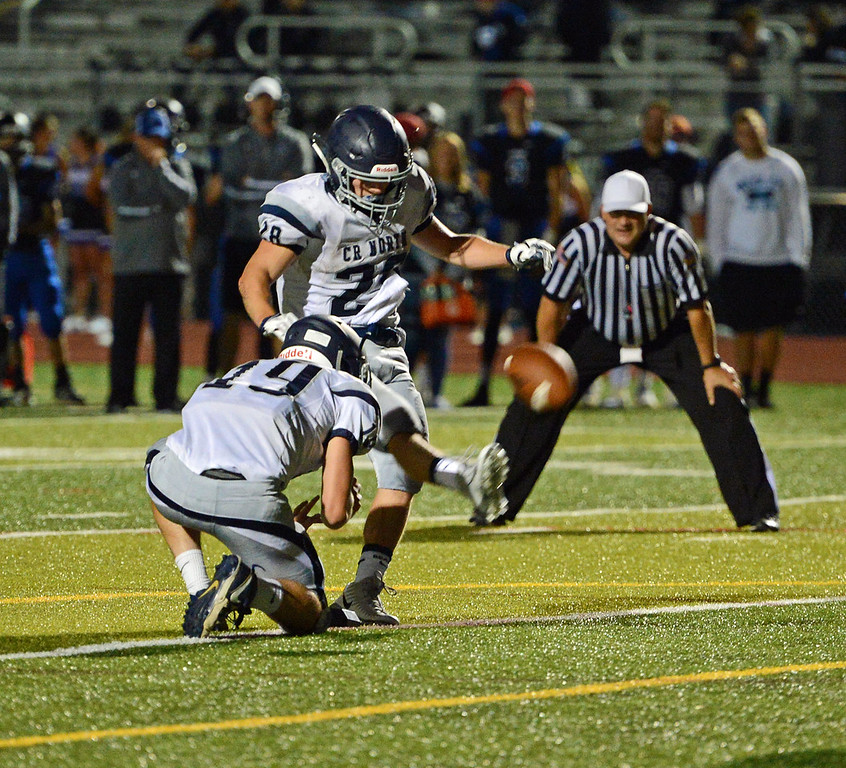 . Mike Welde (28) kicks the extra point.