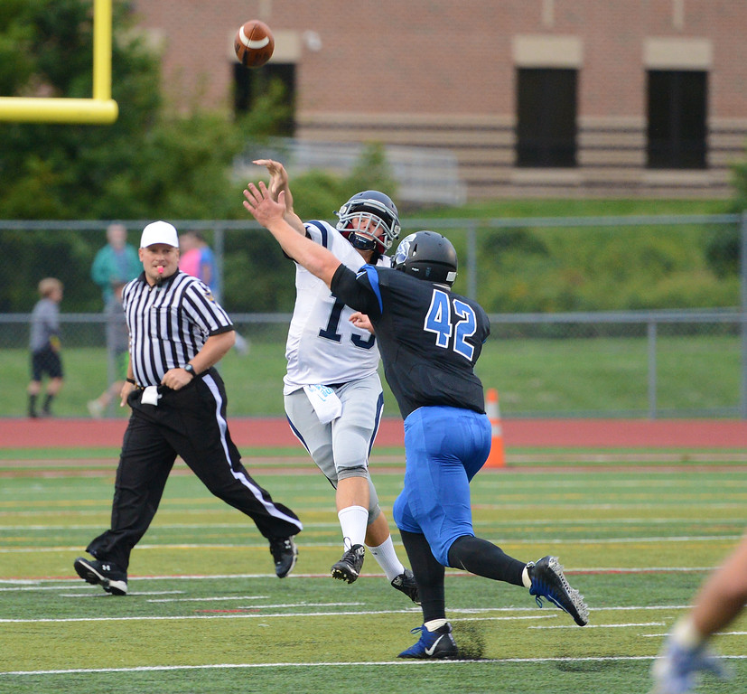 . Council Rock North\'s first-year senior QB Adam Charen (13) completed 11 of 22 passes in Indians\' battle with CB South Sept. 1 on the Titans\' home field, Warrington, Pa.