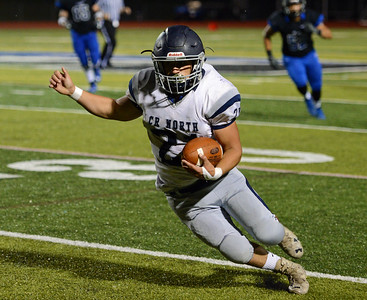 Rob Ranelli (21) scored North's sole TD.