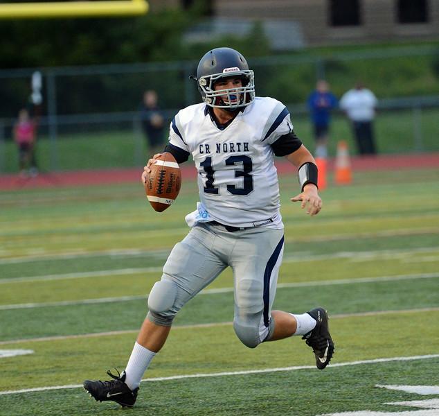 Adam Charen (13) looks for open receiver.
