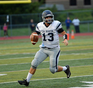 Adam Charen (13) looks for open receiver.