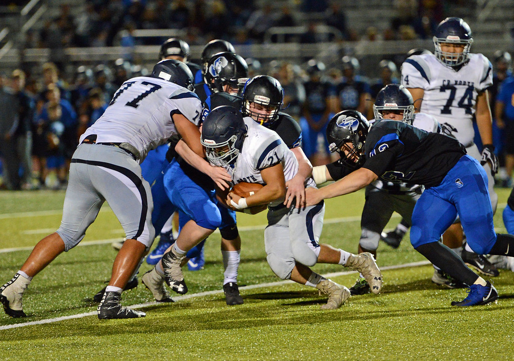 . Rob Ranelli (21) picks up tough yards for the Rock.