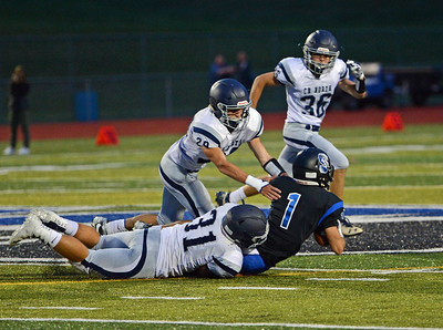 Mike Welde (28) and Nick Forsyth (31) bring down Ryan Watson (1).