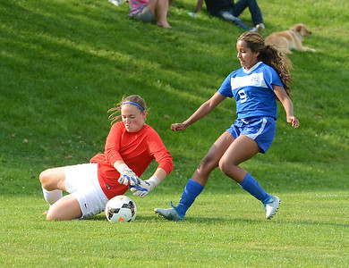Bensalem's Julia Murray (9) pressures Council Rock North goalie Abigail Schroeder (1) in recent girls soccer duel between the schools won by the Lady Indians in overtime. (John Gleeson – 21st-Century Media)