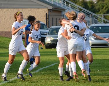 CR North players celebrate Paige Addis' winning goal.