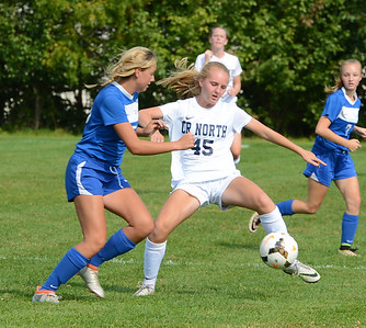 Heather McLaughlin (45) stretches out for free ball.