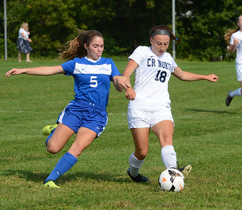 Kaleigh O'Donnell (18) wins battle for possession.