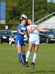 Caroline Erlandsen (17) goes all out to win head ball.