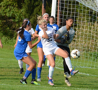 Council Rock North's Ali Zingaro (32) collides with Alayna McSeed (0) in front of Bensalem goal in recent girls soccer duel between the schools won by the Lady Indians in overtime. (John Gleeson – 21st-Century Media)