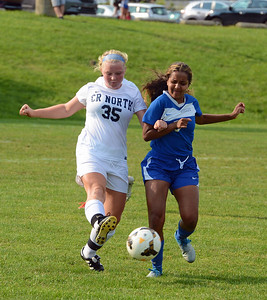 Lily Ries (35) and Julia Murray (9) battle for possession.