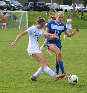 Brooke Strobel (12) centers the ball.