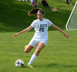Chloe Hill (25) clears ball from CR North territory.