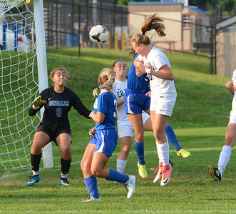 Paige Addis (10) scores winning goal in North's double overtime 3-2 win.