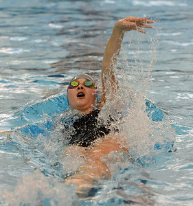 Abigail Henderson swims the backstroke.