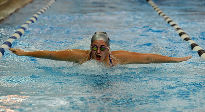 Eva Wojnovich swims the third leg of the 200 butterfly, heat two.
