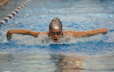 Emily Nelson swims last leg  in heat one butterfly relay.
