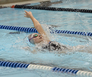 Christina Calibeo swims final leg of 200 backstroke.