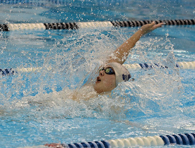Connor Boucher swims the backstroke.