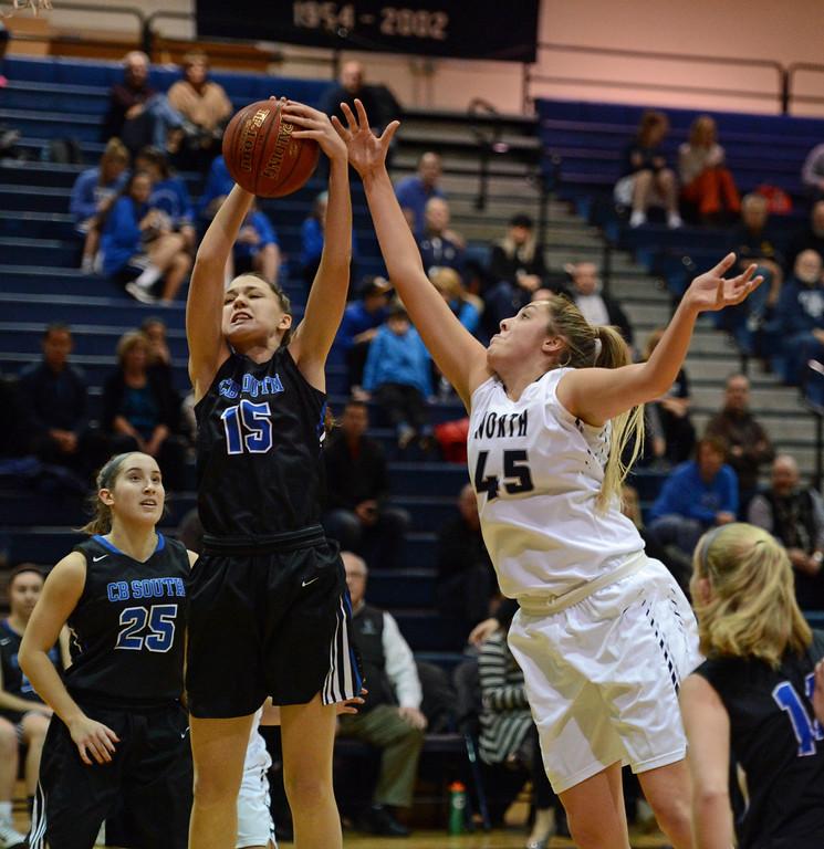 . Mackenzie Tinner (45) and Allie Burke (15) battle for a rebound.