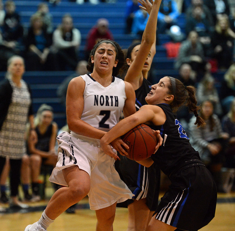 . Becca Margolis (2) is fouled  on way to the hoop.