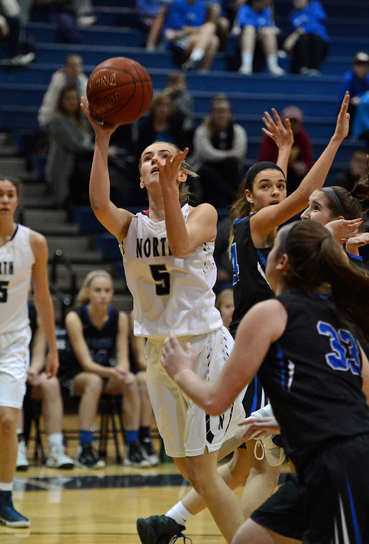 . Camryn Polinsky (5) drives to the hoop.