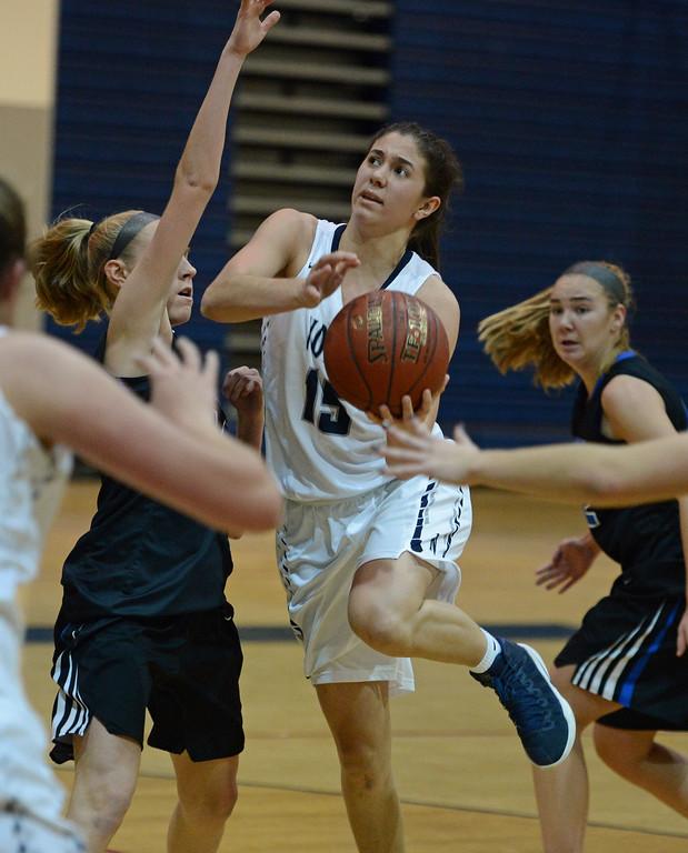 . Dana Bandurick (15) drives to the hoop.