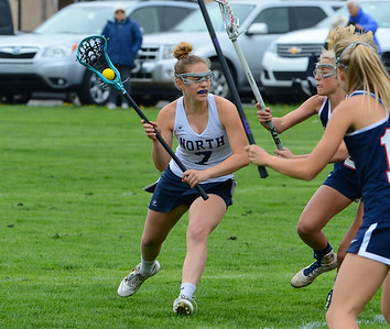 Council Rock North senior Anna Lehman (7) looks for opening in CB East defense in a recent girls lacrosse matchup between the schools. (John Gleeson – 21st-Century Media)