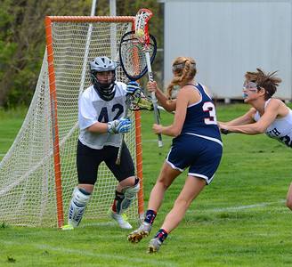 Margaret D'Auria (42) stands tall in the goal for Rock.