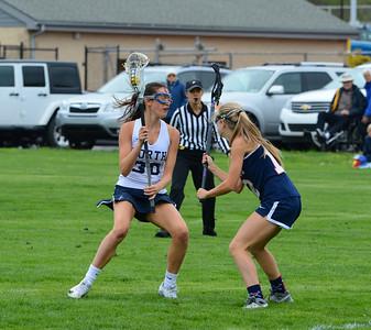 Megan Haggerty (30) tries to maneuver around Julia Gleason (12).