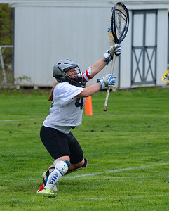 CR North goalkeeper Margaret D'Auria (42) concentrates on save.
