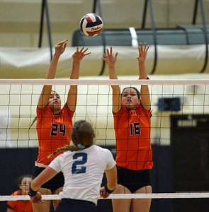 Elley Torres (24) and Shelby Hastings (16)  block shot for the Falcons.