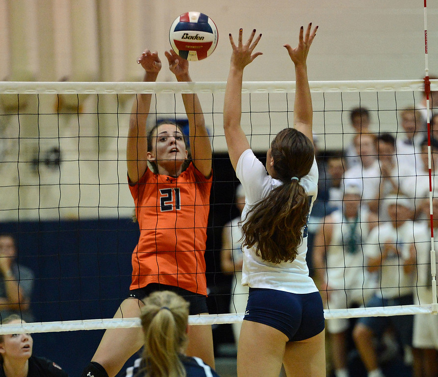 . Julia Vreeswyk (21) finesses the ball over the net.