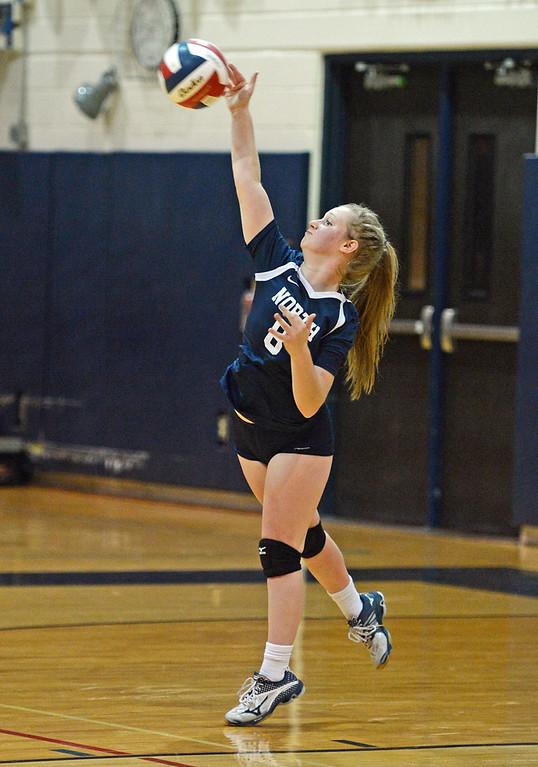 . Grace Schweizer (8) holds serve.
