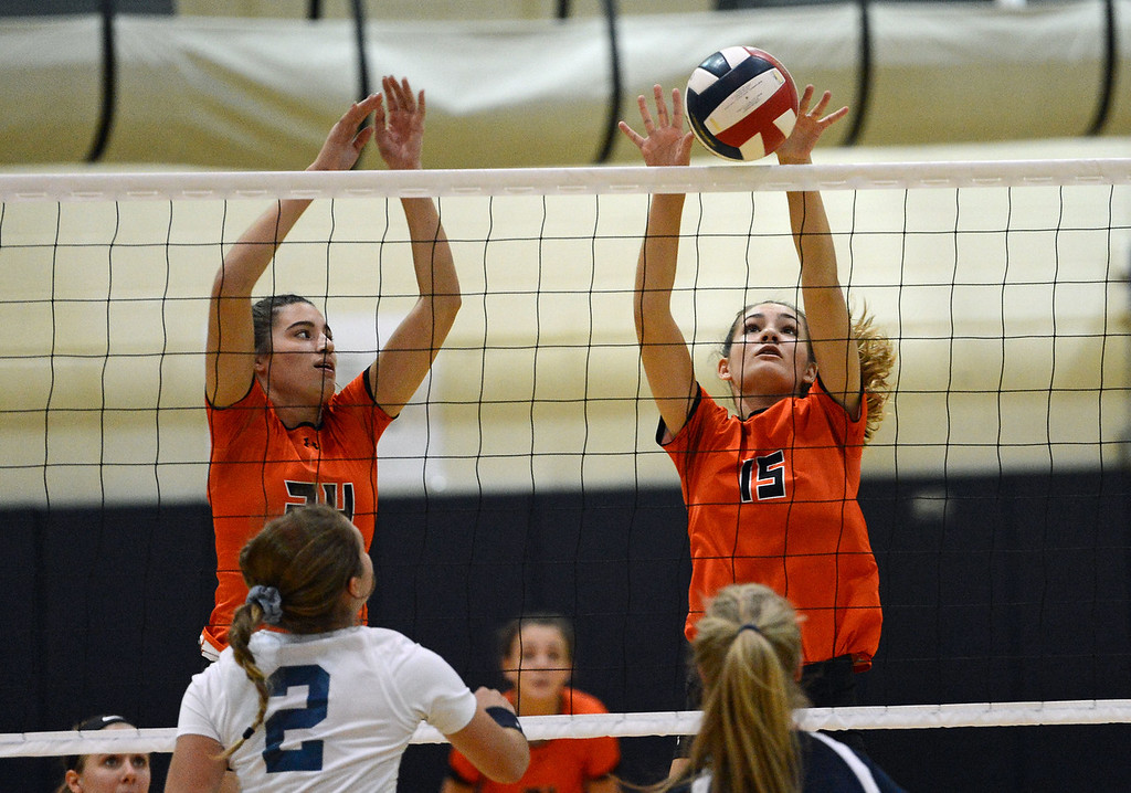 . Brooke Burns (15) and Elly Torres (24) try to block Jenna Hron\'s (7) shot.