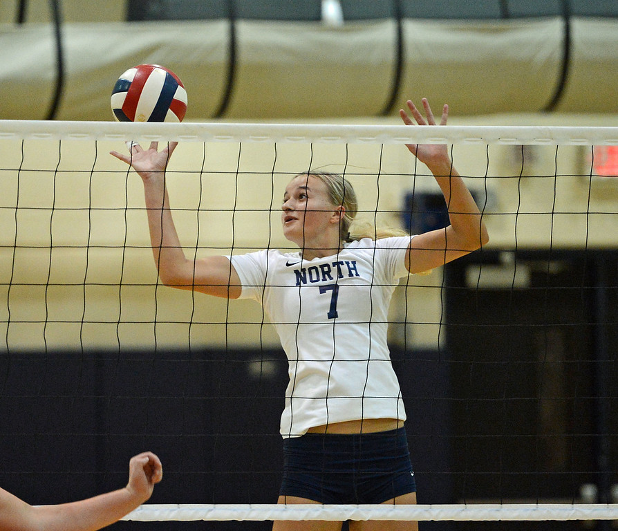 . Jenna Hron (7) finesses ball over the net.