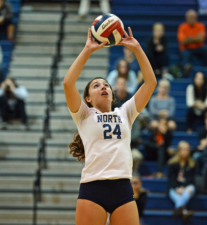 . Sarah Caola (24) sets the ball for CR North.