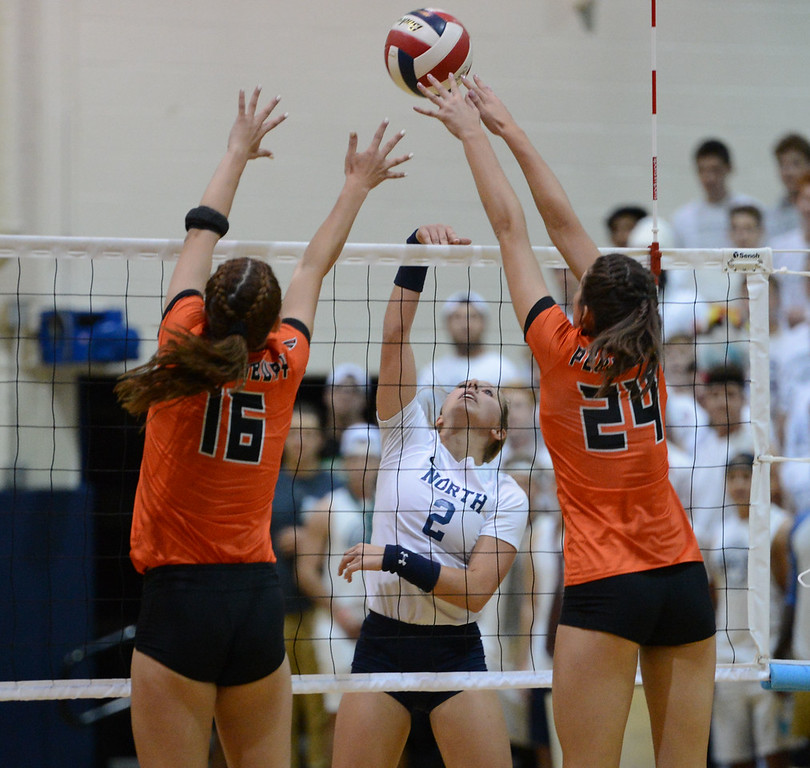 . Maddy Moore (2) finesses ball by Shelby Hastings (16) and Elley Torres (24).