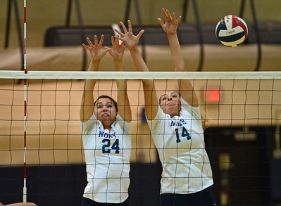 Sarah Caola (24) and Mackenzie Tinner (14) go up for a block.